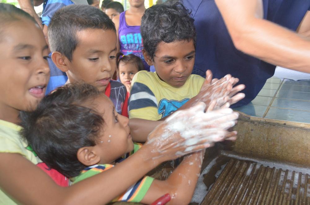 Kid washing hands clinic health.JPG