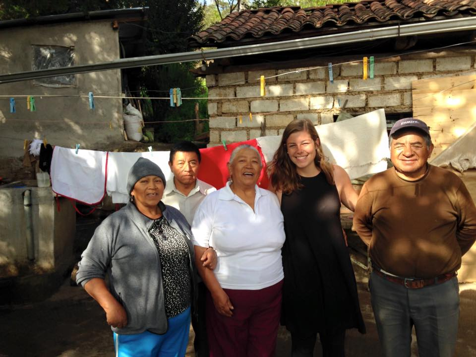 Former Program Director Alex, with Clemencia and her family at Clemencia's home in Amaguaña, Ecuador.