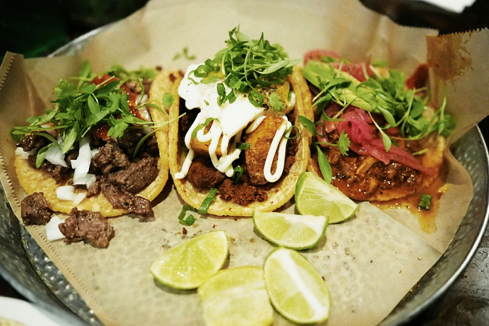 tacos carne asada, chorizo rojo con huevo  and  cochinita pibil.