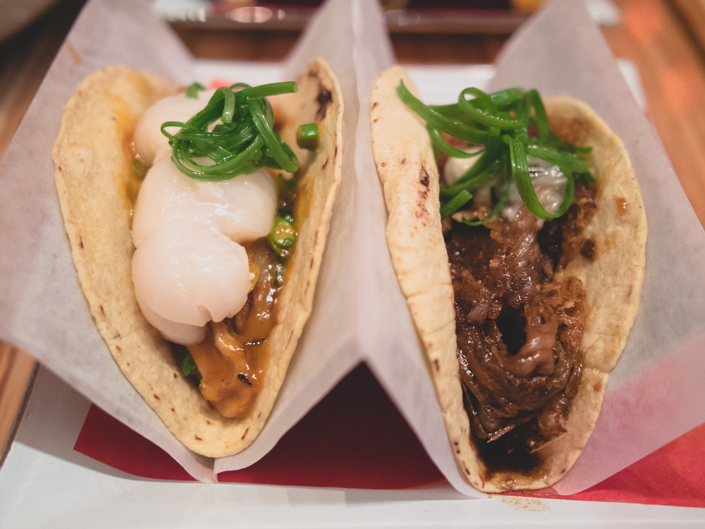 tacos silencio (braised duck tongue, fresh lychee) and viva china (beef tenton, kumamoto oysters).