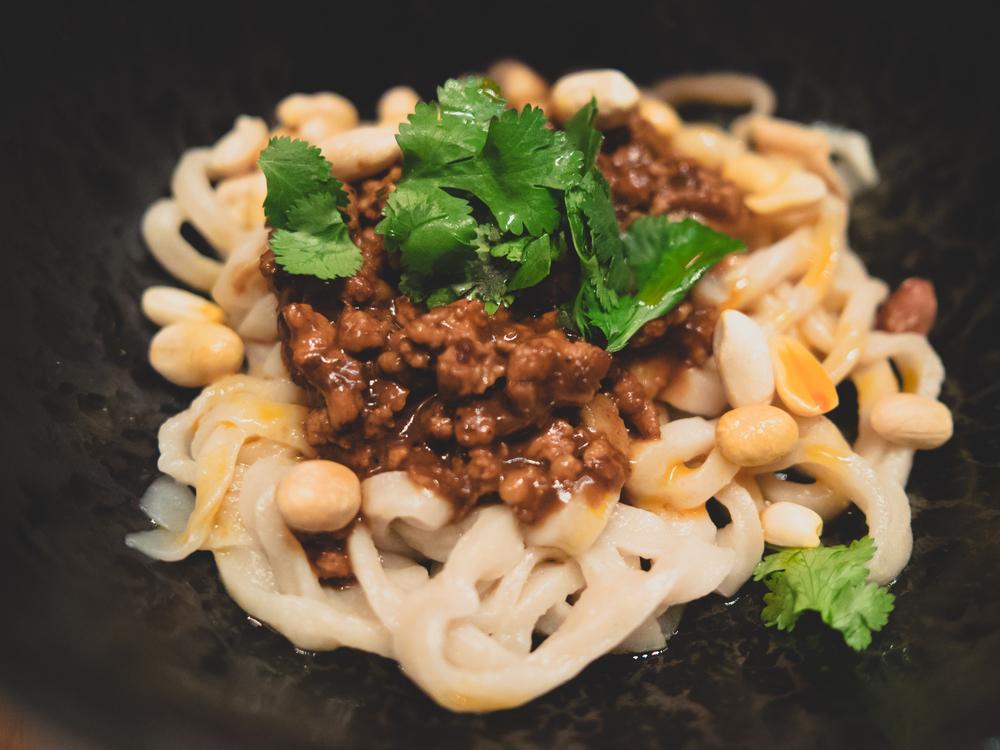 dan dan mian : hand-cut wheat noodles, spicy pork sauce and peanuts.