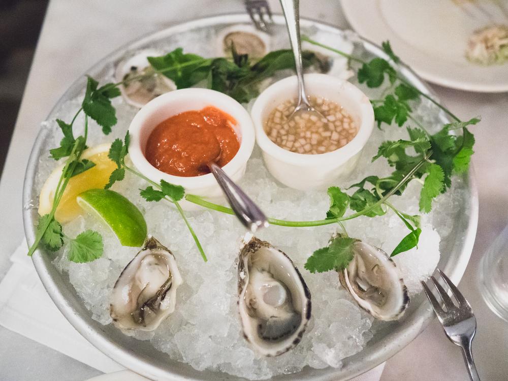 half dozen  raw oysters .