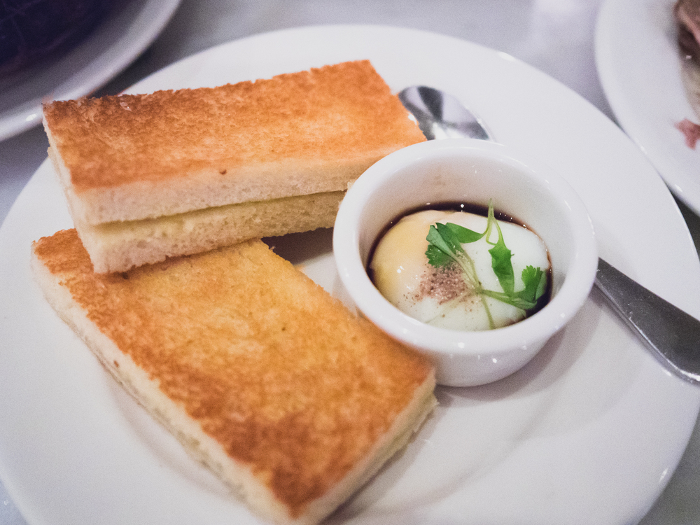 kaya toast with coconut jam, butter, slow cooked egg and soy.