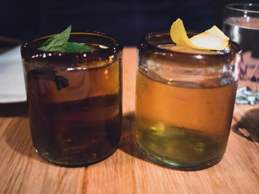 the pedro guerrero (diplomatico exclusiva rum, lucano, walnut, mole bitters, mint) and the aztec colonel (old grand dad bonded bourbon, benedictine, ancho, mole and orange bitters).