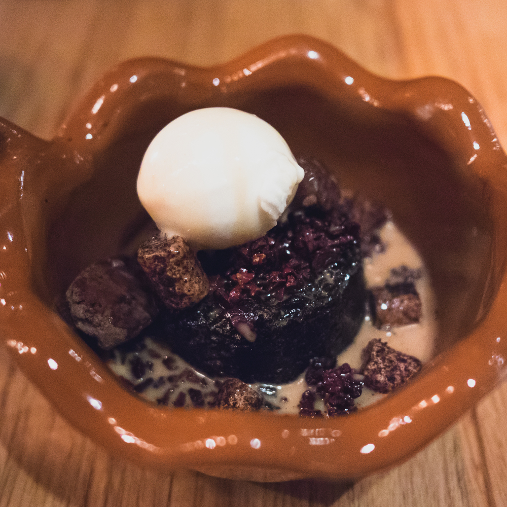 abuelita hot chocolate: ancho-chocolate cake, alpaco ganache, candied cocao nib, milk ice cream, abuelita broth.