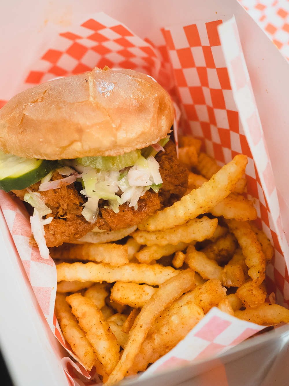 hot chicken sandwich with fries.