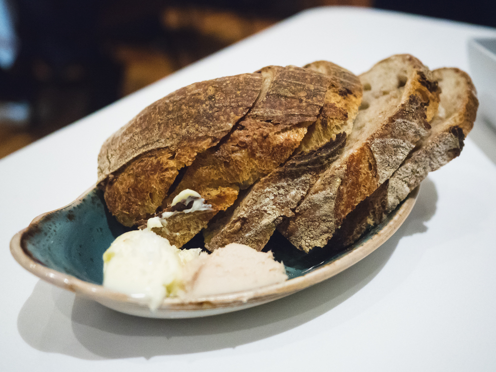 house bread  with salted butter and smoked lardo.