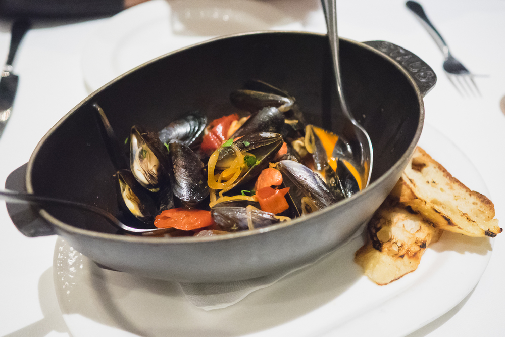 penn cove mussels  with baby chorizo, sherry-piquillo pepper broth, charred crouton.
