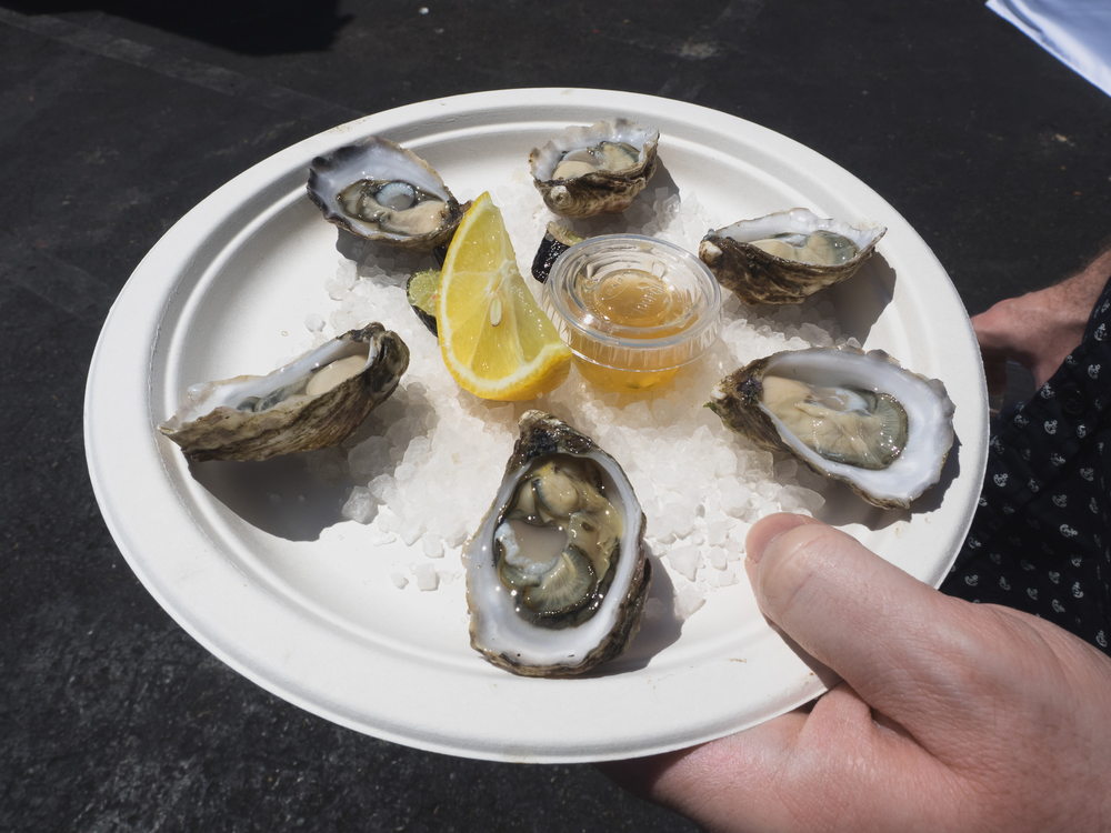half a dozen kumamoto oysters from  the jolly oyster .