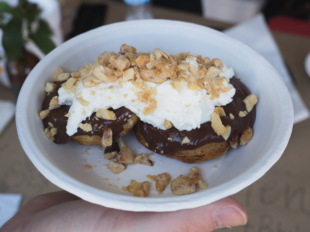 biscuit with chocolate sauce, whip cream and spicy peanuts.