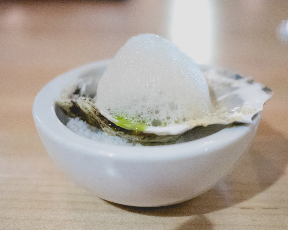 amuse. pleasant bay oyster, apple mignonette, apple foam, lemon balm oil.