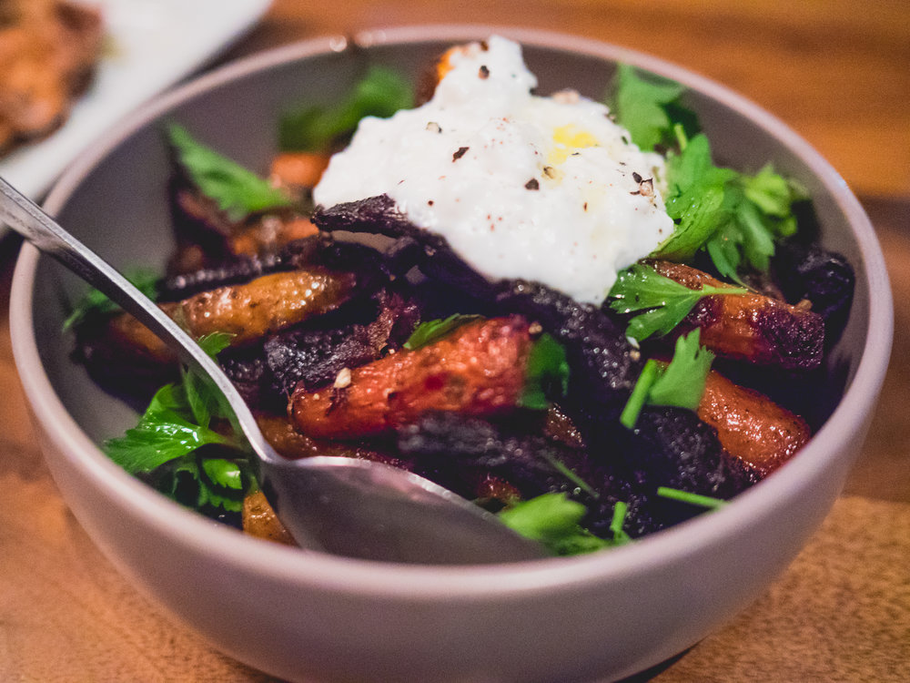 coal roasted carrots , sheep's milk ricotta, herbs, honey and black pepper.