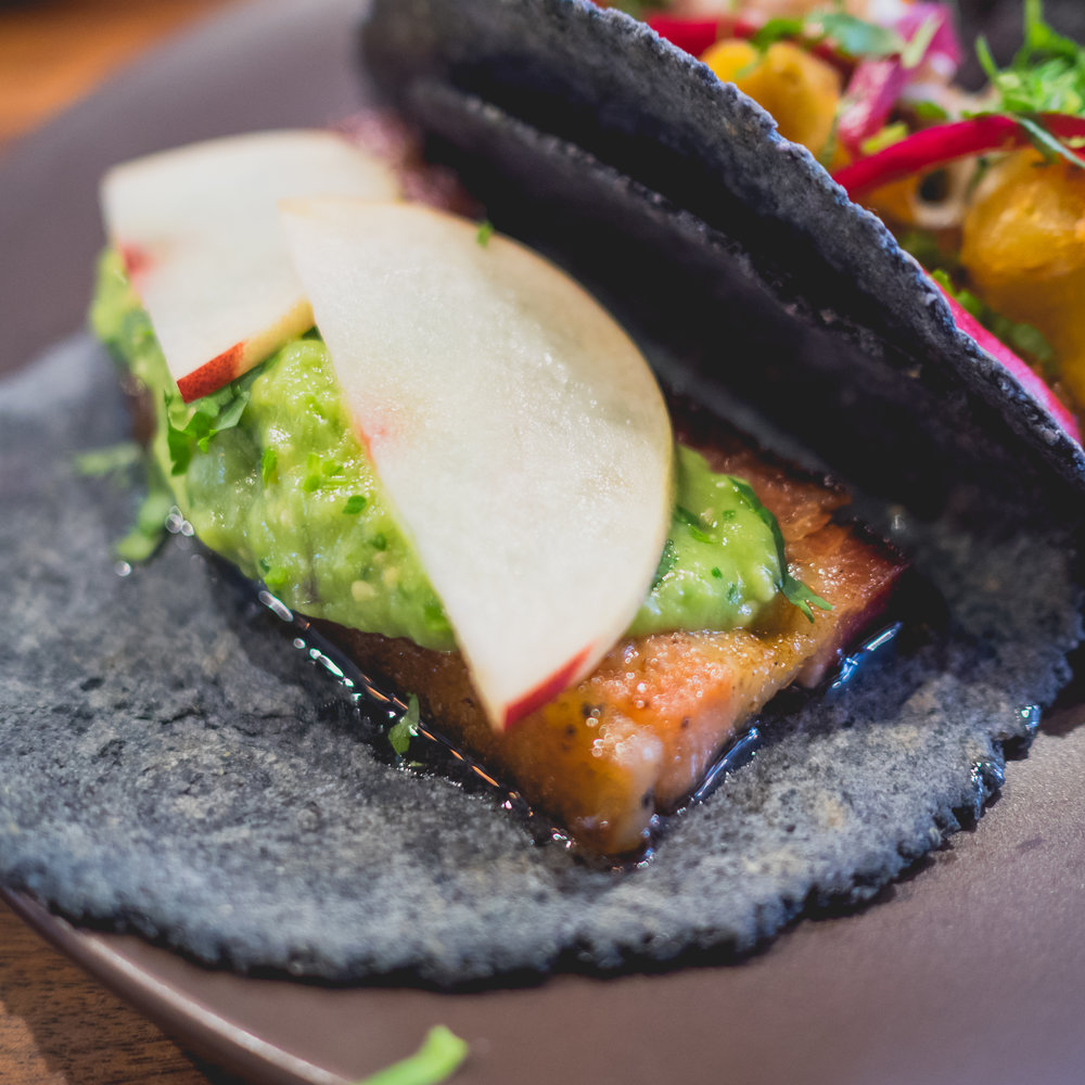 tocino : pork belly, piloncillo glaze, andy's orchard stone fruit, salsa de aguacate, cilantro.