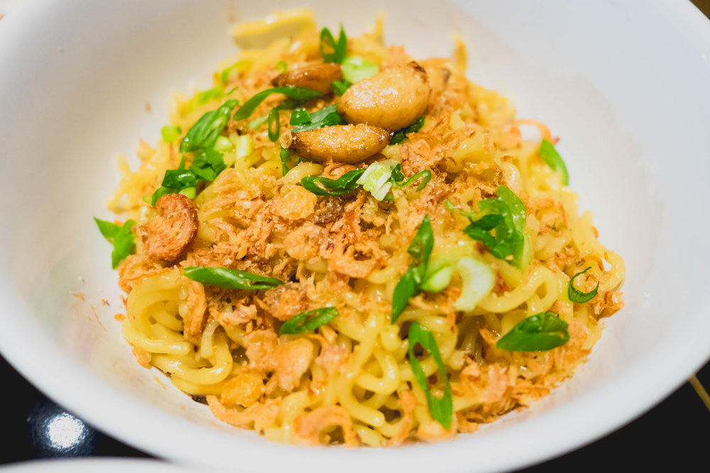 garlic noodles: fried ramen noodles, clarified brown butter, oyster sauce, chicken fat.