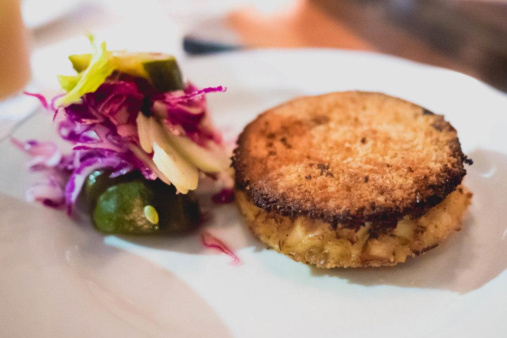 maryland blue crab cake, in-house dill pickles, whole grain mustard remoulade.