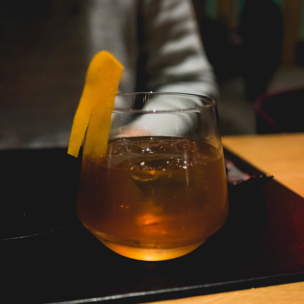 downtown: toasted hazelnut-infused old forester bourbon, pierre ferrand cognac, gilford abricot, demerara.