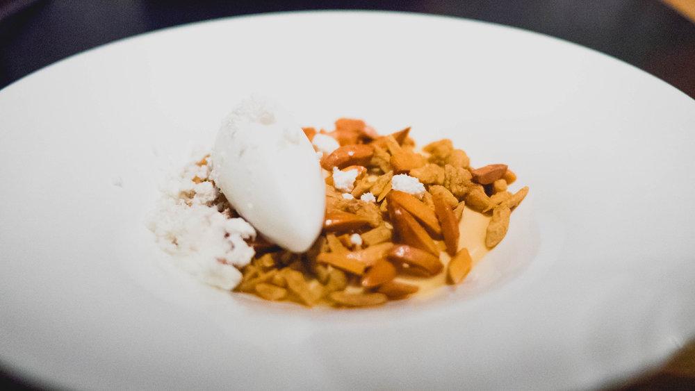 dessert: caramel custard, truffle-praline almonds, young coconut sorbet, vanilla white soy gelee, pork and maple powder.