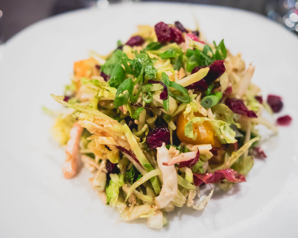 roasted butternut squash salad  with craisins, apple, green onions, crumbled blue cheese, applejack vinaigrette.