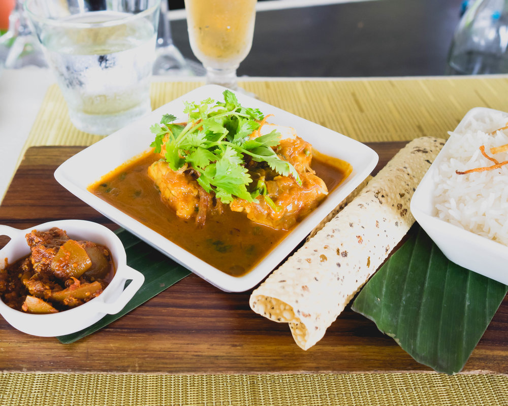 traditional maldivian fish curry  at veli bar with chutneys and fragrant rice.