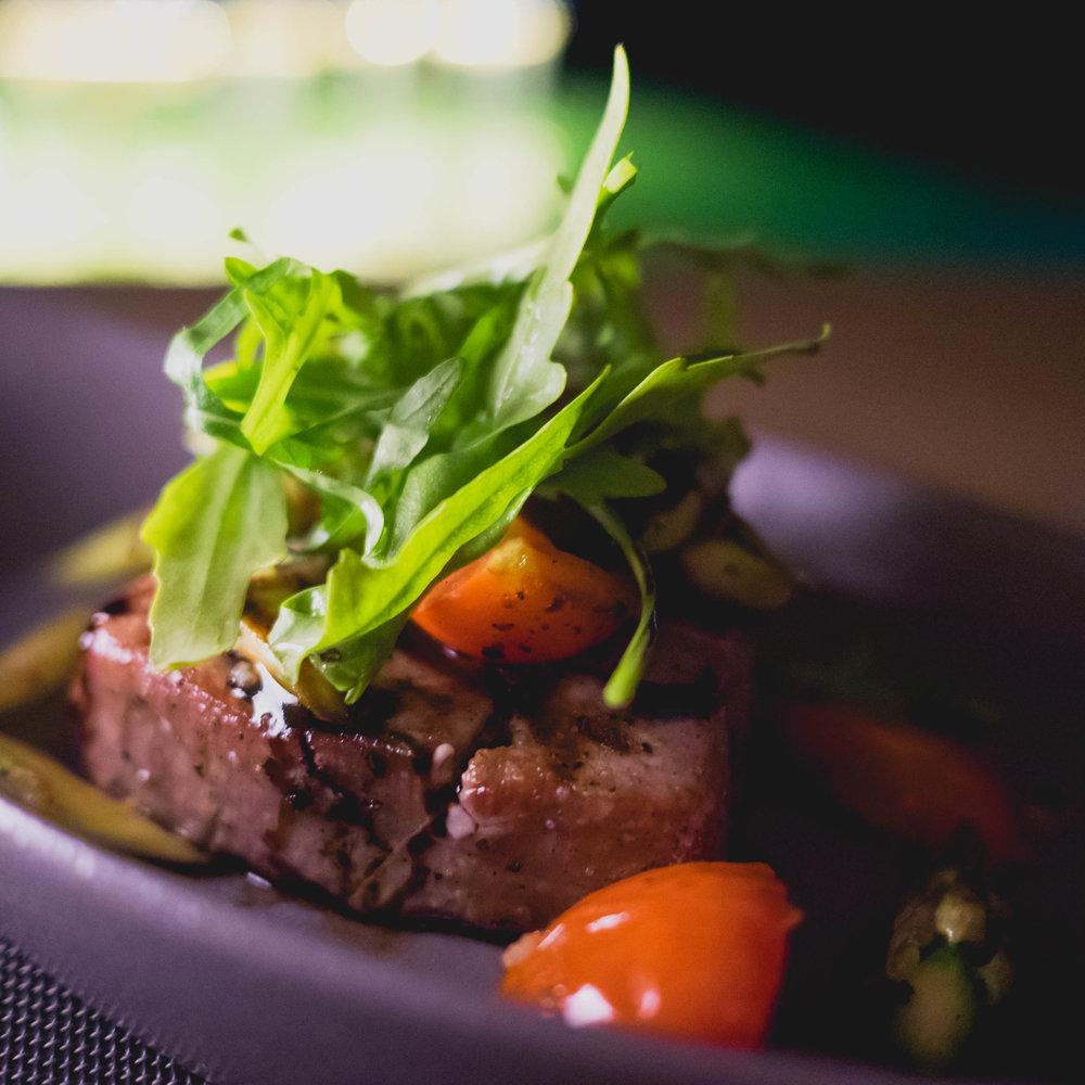 maldivian tuna steak with tomatoes and balsamic vinegar.