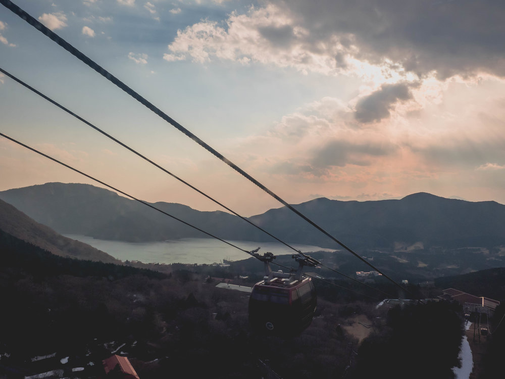 lake ashi from hakone ropeway at sunset.