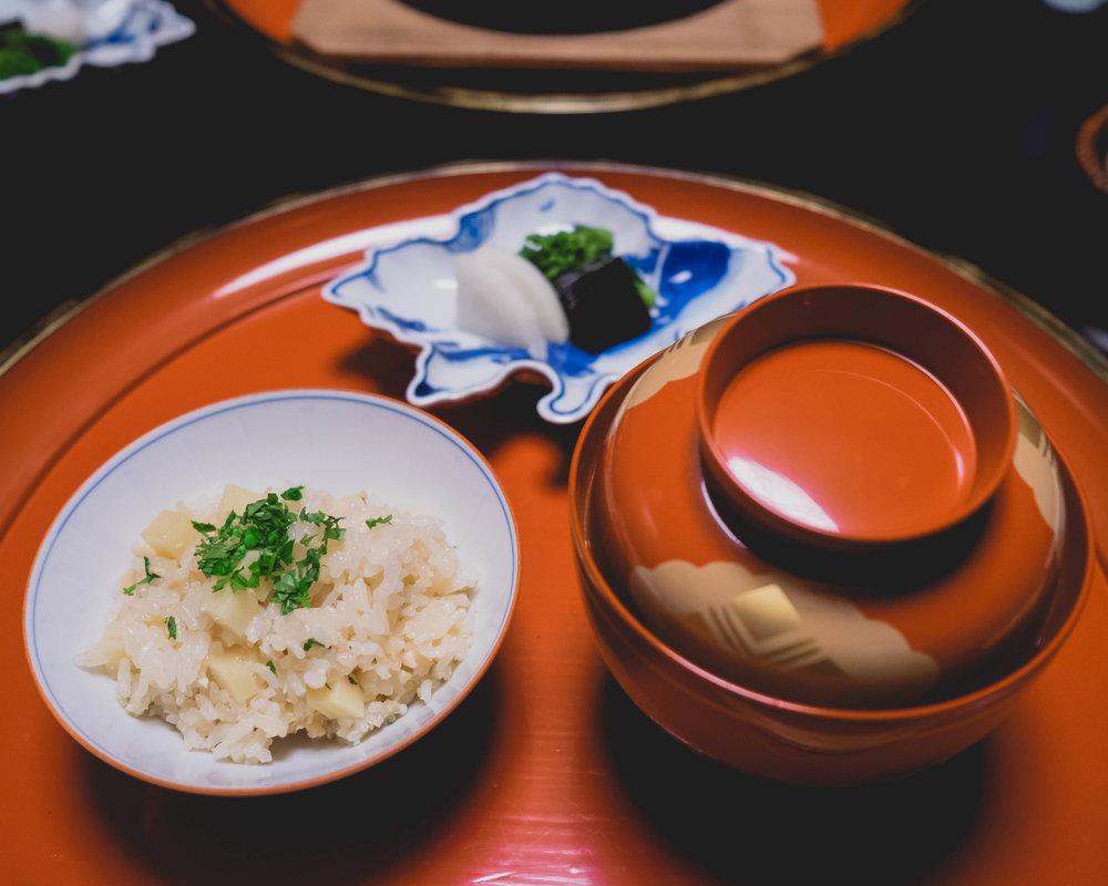 bamboo shoot rice , kinome herb; salt-pickled rapini, pickled daikon radish, salt-cured giant kelp.