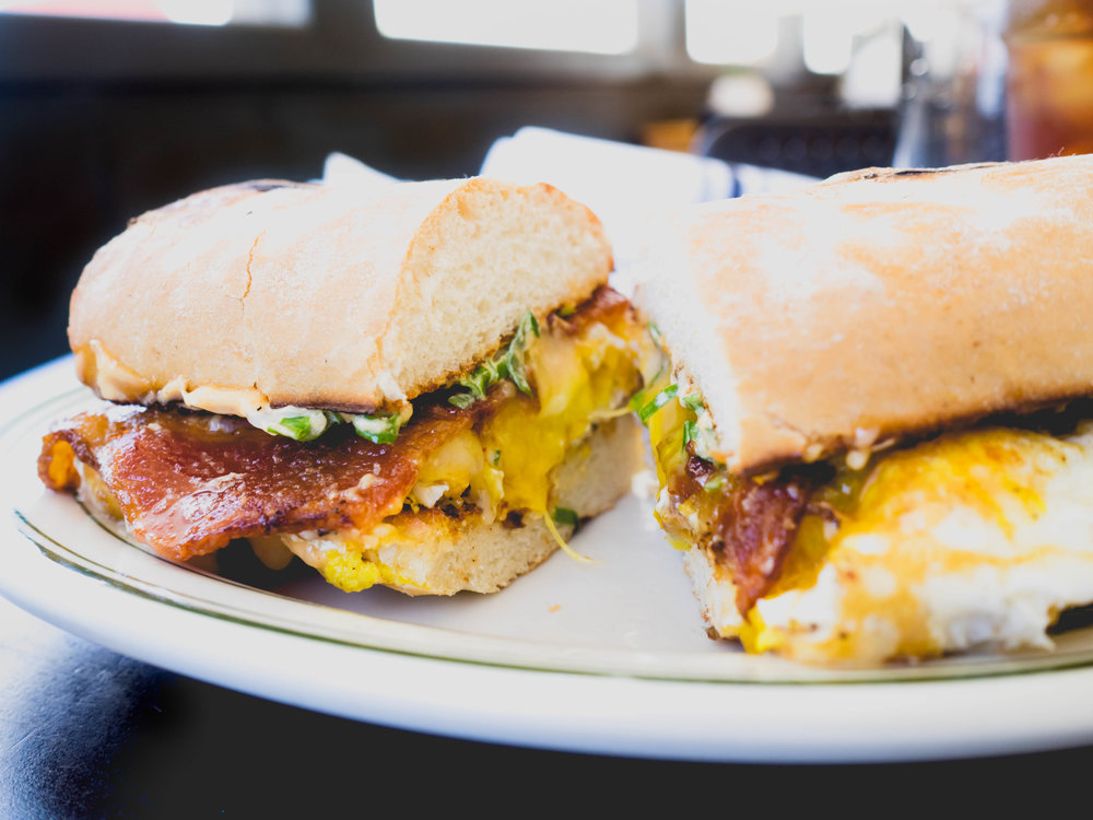 B-E-C : beeler's uncured bacon, fried eggs, sharp cheddar, green onion, sambal mayo, toasted soft baguette.