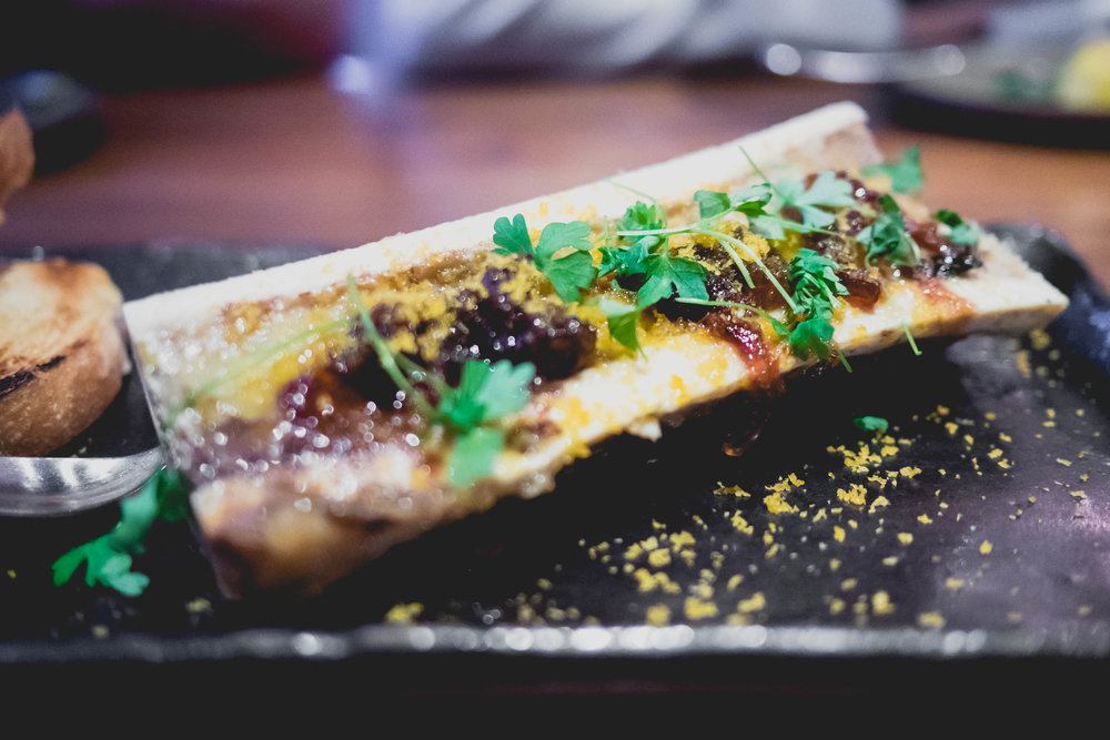 roasted bone marrow , caramelized onions, bottarga, micro parsley.