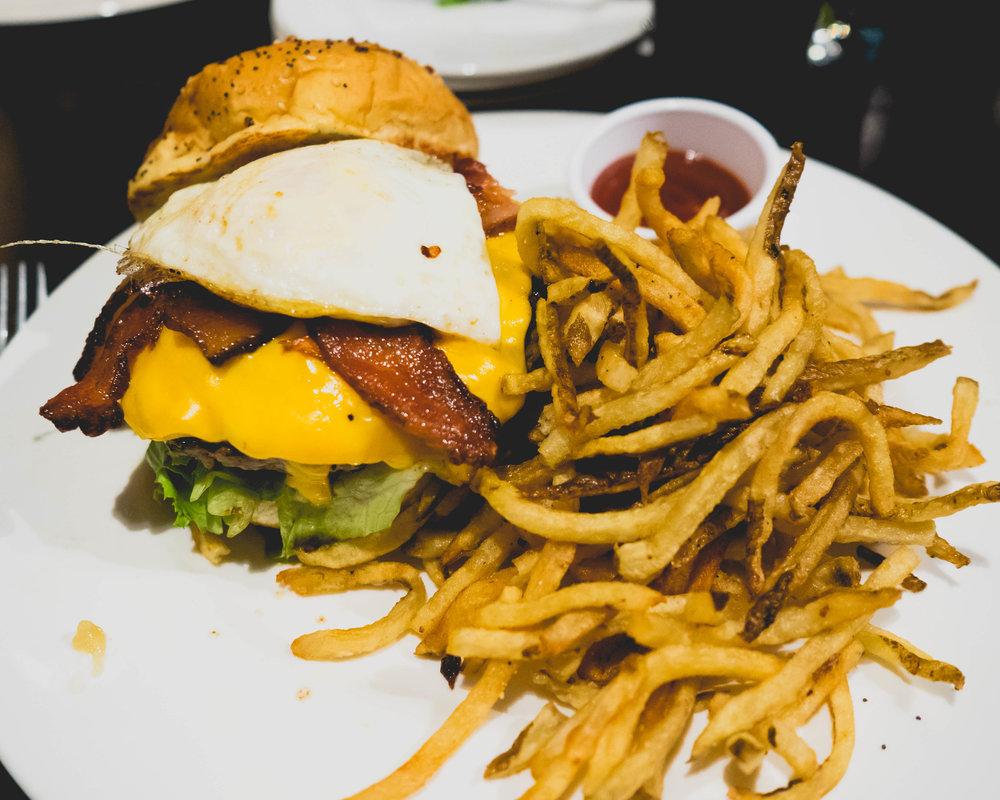 the farmhouse burger : american cheese, fried egg, smoked bacon, garlic aioli.