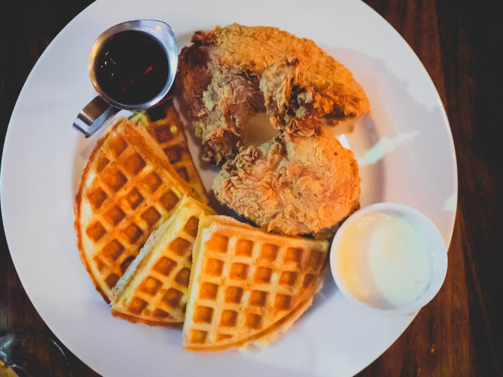 buttermilk fried chicken and waffles, butter, maple syrup.