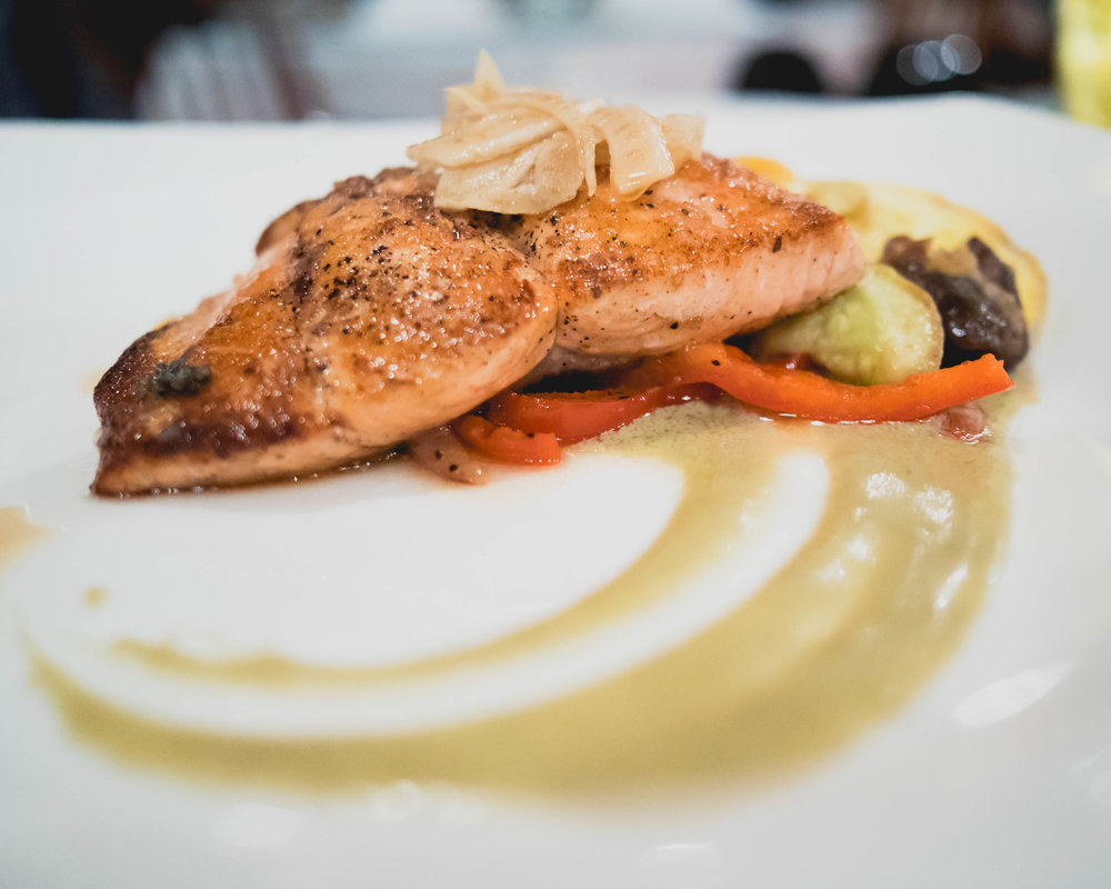 7oz seared local wild salmon , fava beans, petite vegetables, pickled fennel, artichoke puree, paddlefish caviar.