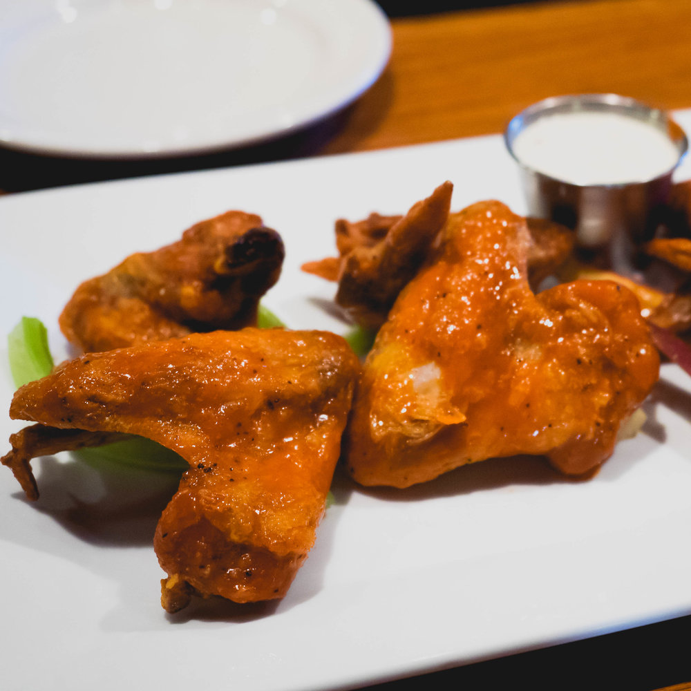 jumbo chicken wings  with buffalo sauce.