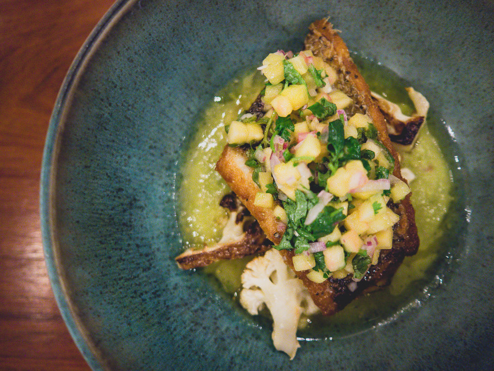 roasted seabass , salsa verde, cauliflower, pineapple.