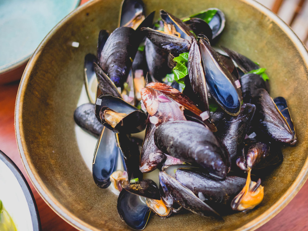 steamed mussels , mezcal, basil, mint, chili.