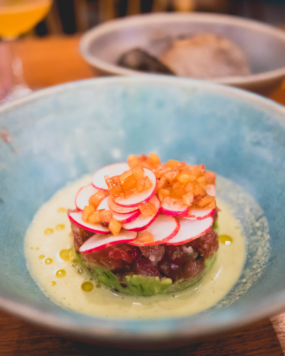 tuna tartare , jalapeno emulsion, radishes, chili oil, avocado.