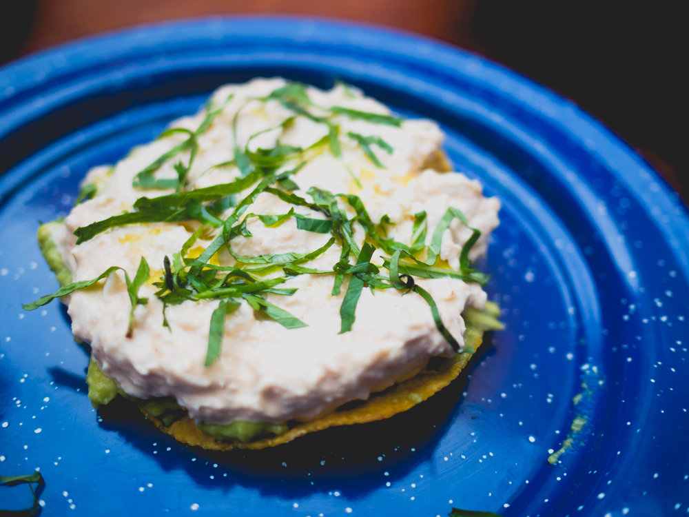 crab tostada , chili mayo, fresh herbs.