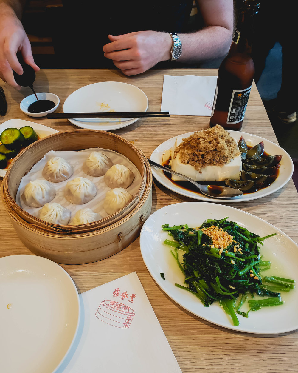 cucumbers; xiao long bao; silken tofu with pork floss and century egg, water spinach .