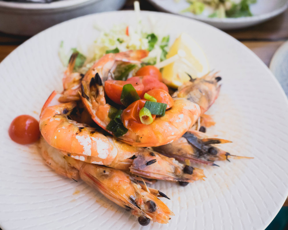 split and grilled yamba prawns with coriander, chipotle and lime butter.
