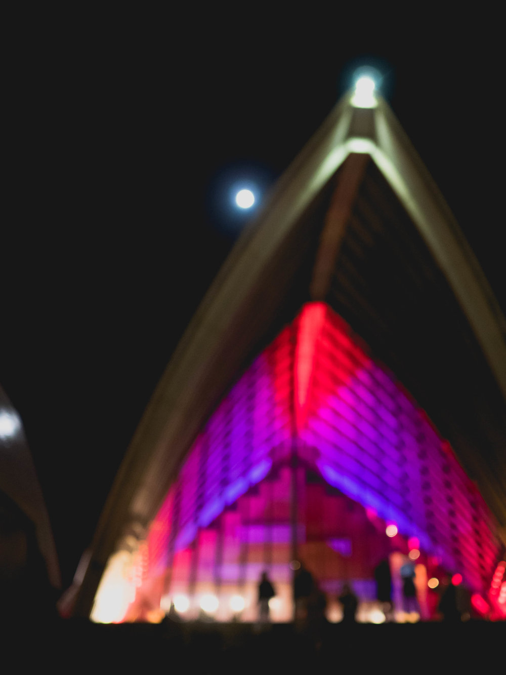 opera house lit up at night.