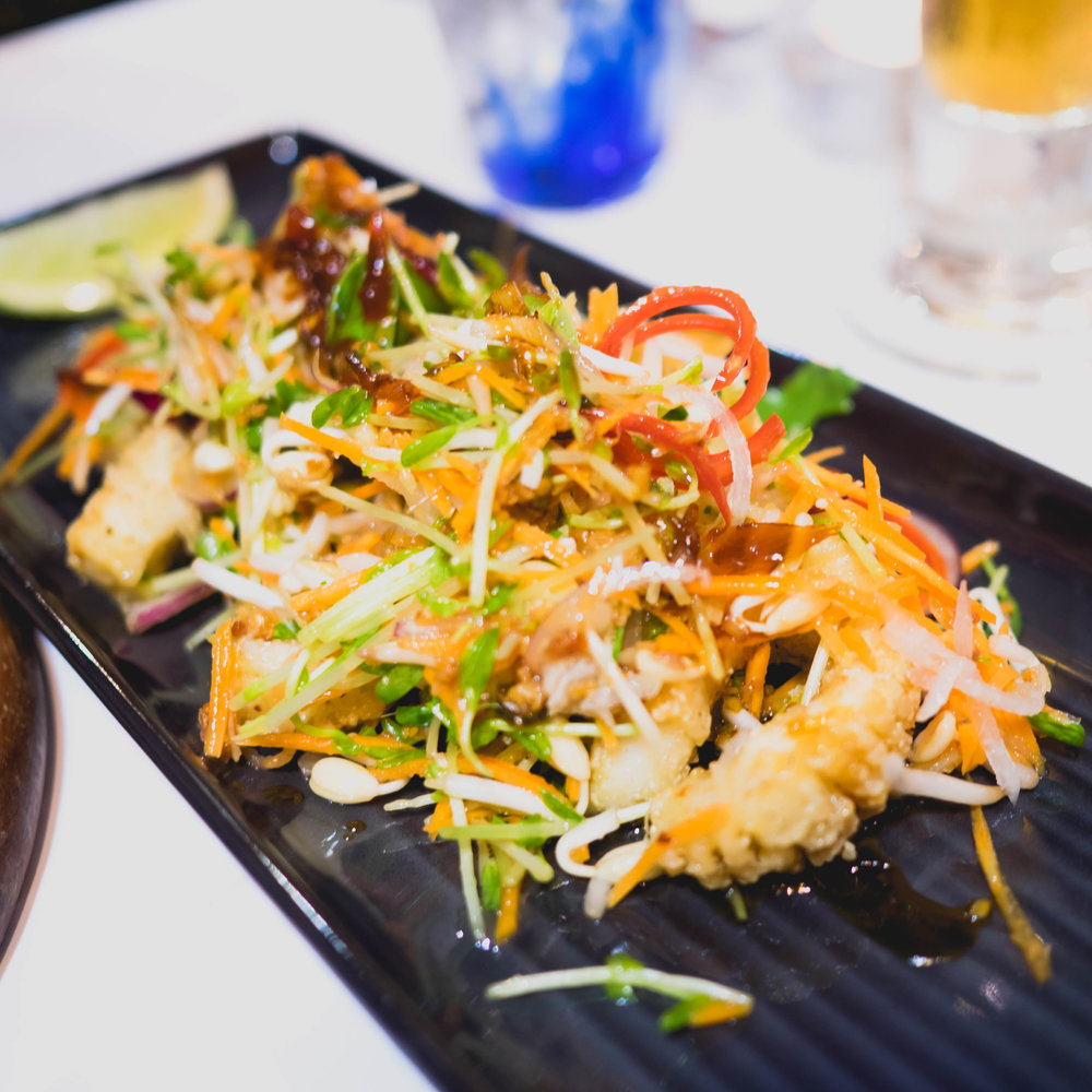 three pepper calamari  with bean sprouts, chilli, coriander, peanut nahm jim, pickled paw paw.
