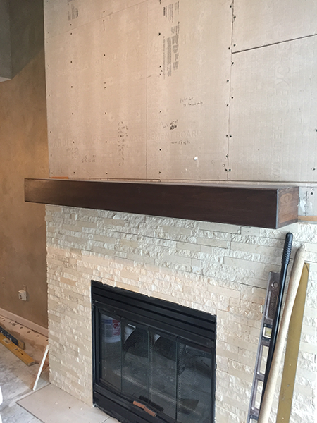 stone will go to the ceiling. Made a custom mantel for this project too.