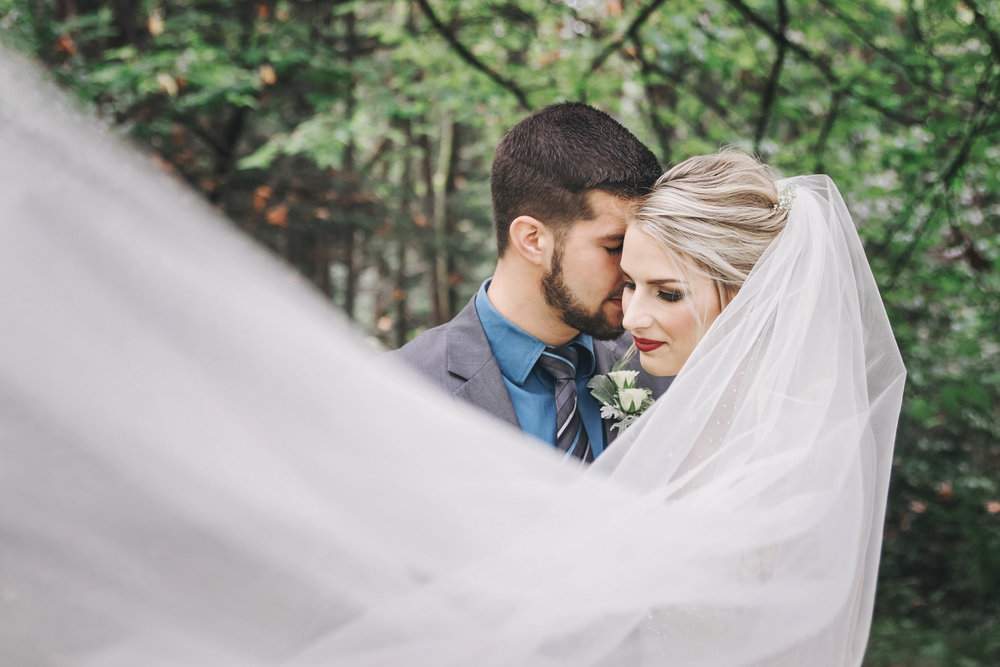 #woodland #wedding #whimsical #ballgown #connection #emotional #fairytale #princess #bride #groom #greywedding #etherealwedding #fairytalewedding #cathedralveil #veil #whitebouquet #simplyupdo #messyupdo #redlips #pearl #babysbreath #white #beard