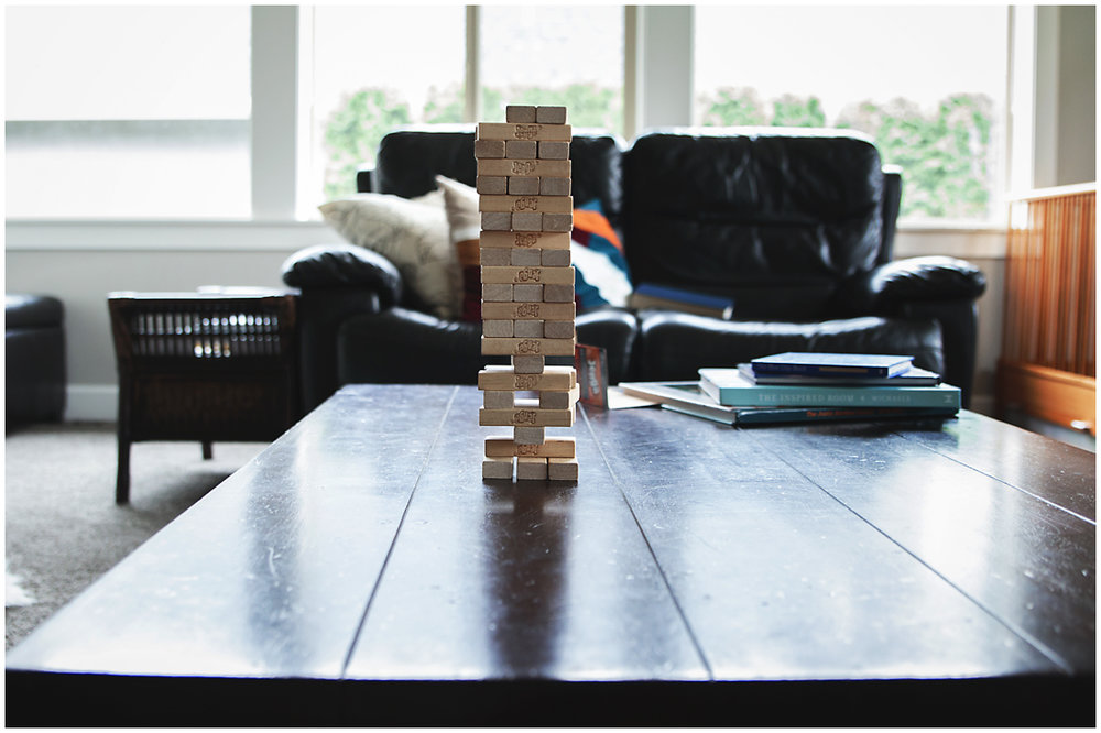 stack of jenga blocks on coffee table  #documentaryphotography #lifestlyephotography #vancouver #langley #fraservalley #mother #father #kids #trampoline #jenga #booknook #lifestyle #inhome #fall #familyof5 #fourthbaby #maternity #reading #whitekitchen #activefathers #playwithyourkids
