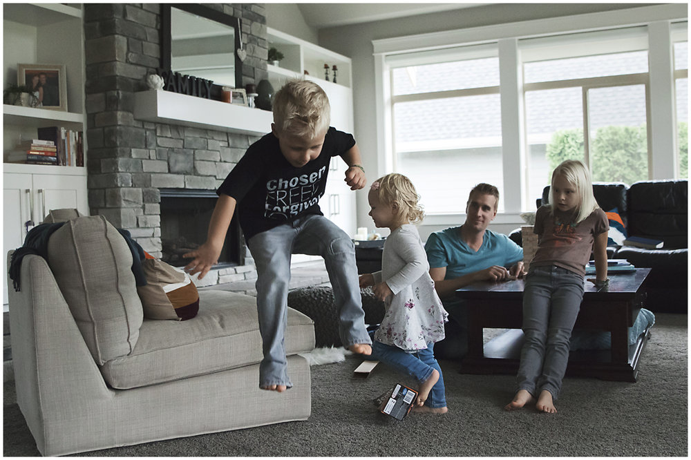 little boy jumping off couch  #documentaryphotography #lifestlyephotography #vancouver #langley #fraservalley #mother #father #kids #trampoline #jenga #booknook #lifestyle #inhome #fall #familyof5 #fourthbaby #maternity #reading #whitekitchen #activefathers #playwithyourkids