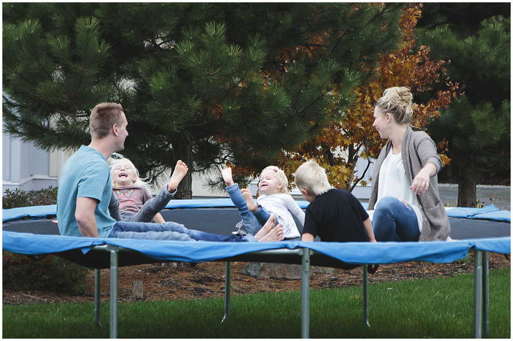 family playing ring around the rosy on the trampoline  #documentaryphotography #lifestlyephotography #vancouver #langley #fraservalley #mother #father #kids #trampoline #jenga #booknook #lifestyle #inhome #fall #familyof5 #fourthbaby #maternity #reading #whitekitchen #activefathers #playwithyourkids