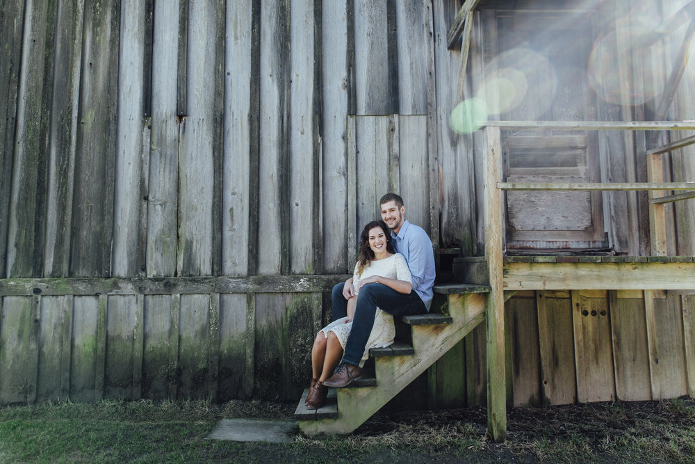 A sunny spring engagement session at Hovander Homestead in Ferndale, Washington. #bunny #engagement #spring #engagement #truck #country #lace #puddles #oldbarn #woodensteps #sunflare #blue
