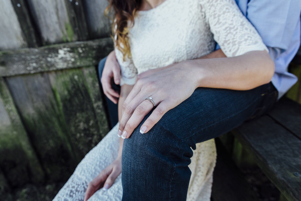 A sunny spring engagement session at Hovander Homestead in Ferndale, Washington. #bunny #engagement #spring #engagement #truck #country #lace #puddles #ring #ringshot #closeup #sitting #pose