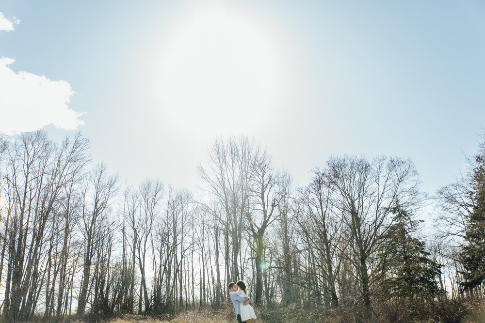 A sunny spring engagement session at Hovander Homestead in Ferndale, Washington. #bunny #engagement #spring #engagement #truck #country #lace #puddles #hovander #hovanderhomestead #sunshine #trees #twirl #hug