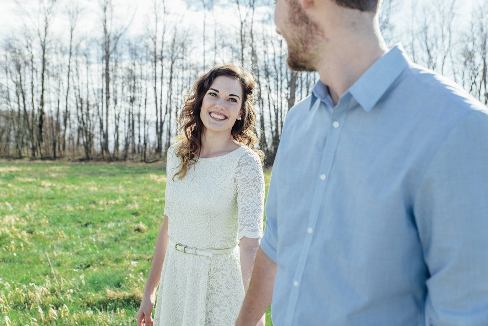 A sunny spring engagement session at Hovander Homestead in Ferndale, Washington. #bunny #engagement #spring #engagement #truck #country #lace #puddles #holdinghands #hovanderhomestead #outdoors #smile #happy #pose