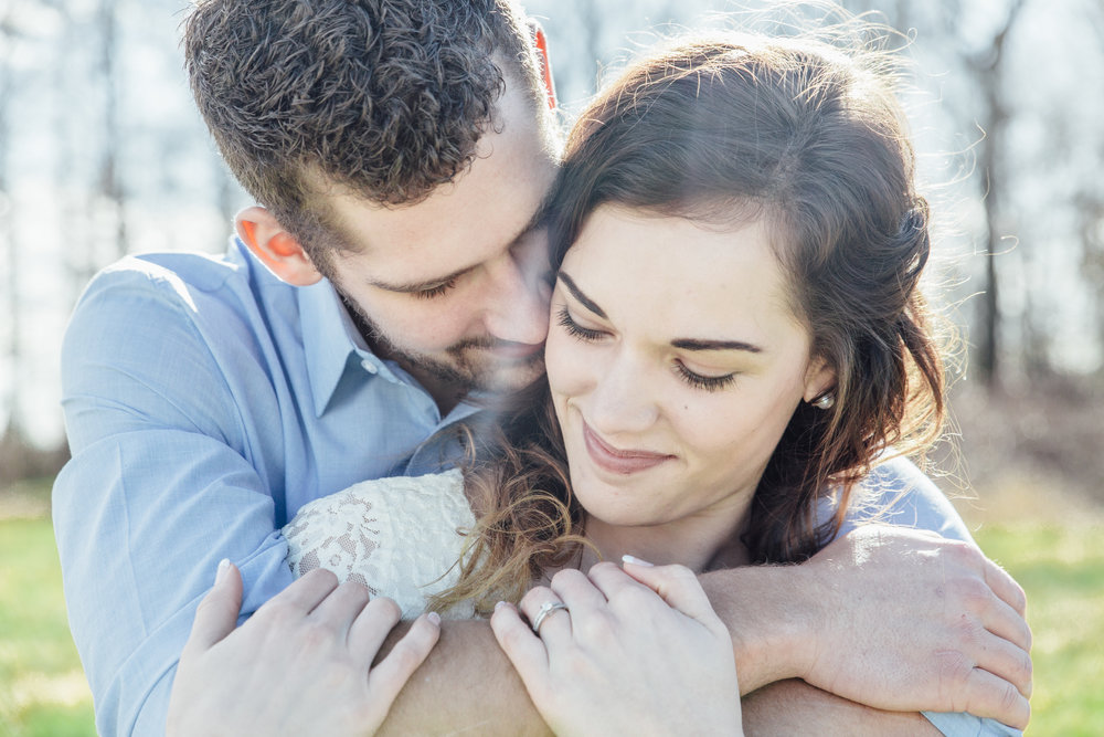 A sunny spring engagement session at Hovander Homestead in Ferndale, Washington. #bunny #engagement #spring #engagement #truck #country #lace #puddles #ring #hug #pose #romanticpose #hug #upclose #emotion #connection #mimsicalphotography